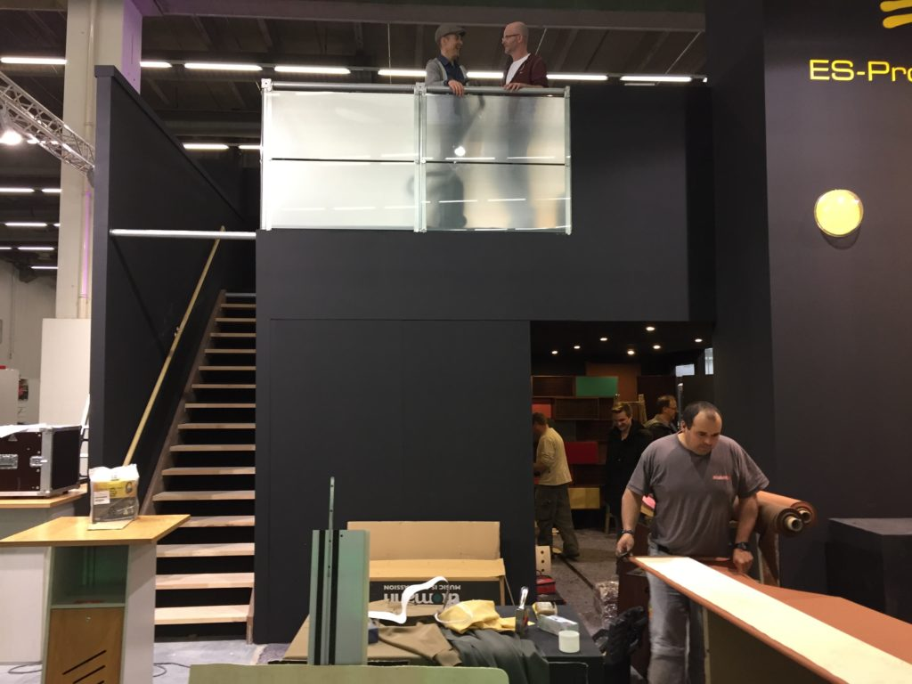 Akustikstoff.com @ Musikmesse 2027 – Stand construction: metres of acoustic fabric still need to be stapled to the wall coverings