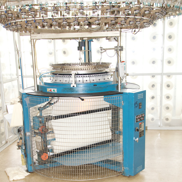 knitting machine for acoustic fabric