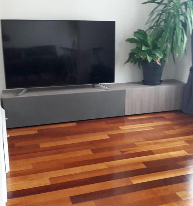 AV board with grey speaker cloth from Akustikstoff.com