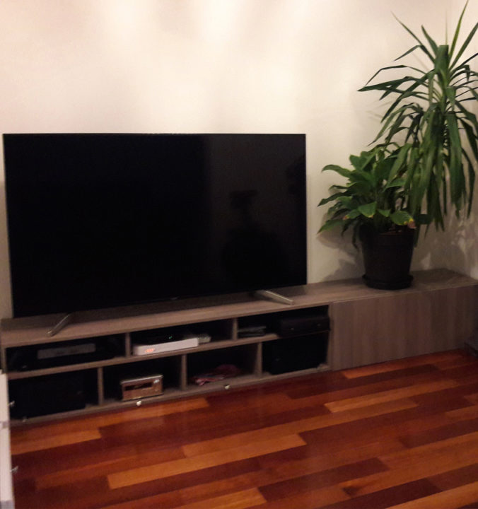 AV board with TV set before beautification with speaker cloth